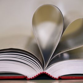 book with open pages shaped into a heart