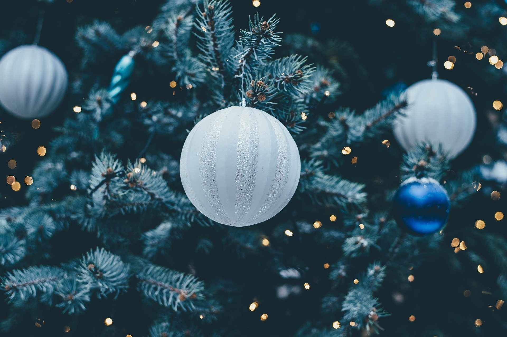 white globe ornament on Christmas tree